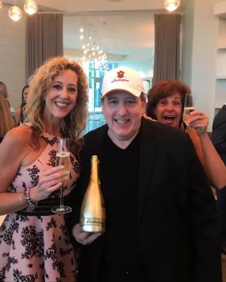 Lisa Dwoskin with Ron Goldberg of Lamborghini Champagne
